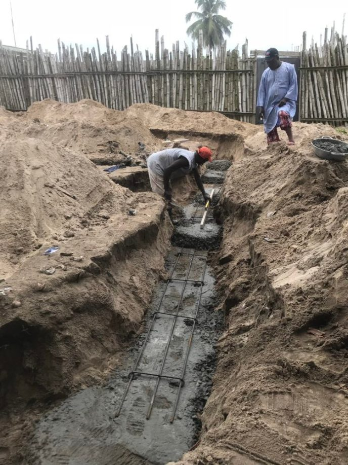 Foundation being poured and leveled for the Love Africa Project's public washroom build in Saltpond, Ghana