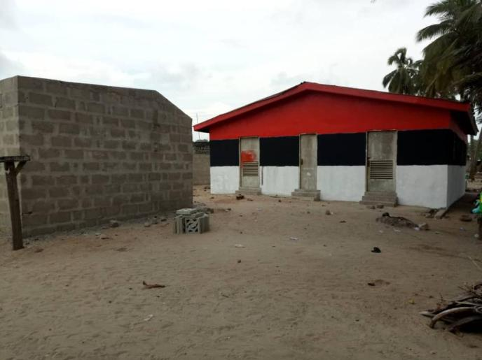 Painting of Love Africa Project public washroom building.