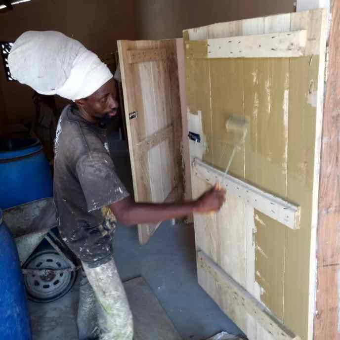 painting public latrine stalls