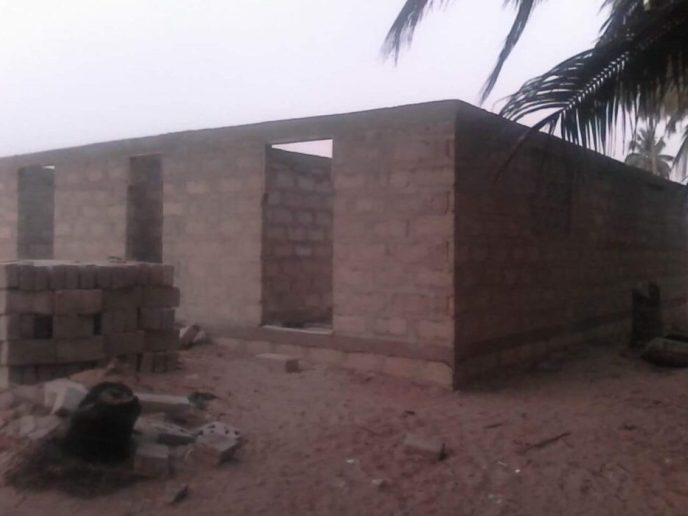 Blocks almost at roof height for 20-toilet public washroom in Saltpond, Ghana