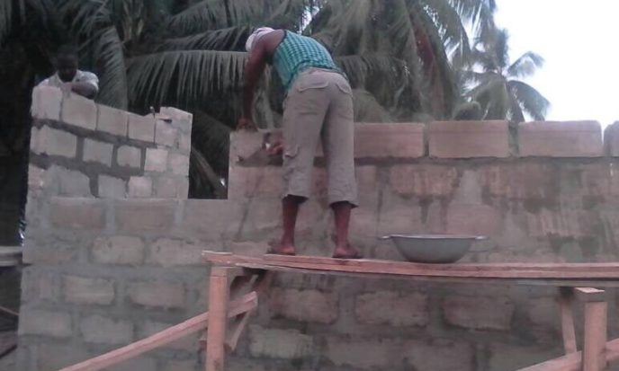 Bricklayer works on 20-toilet washroom build to end open defecation in Saltpond, Ghana