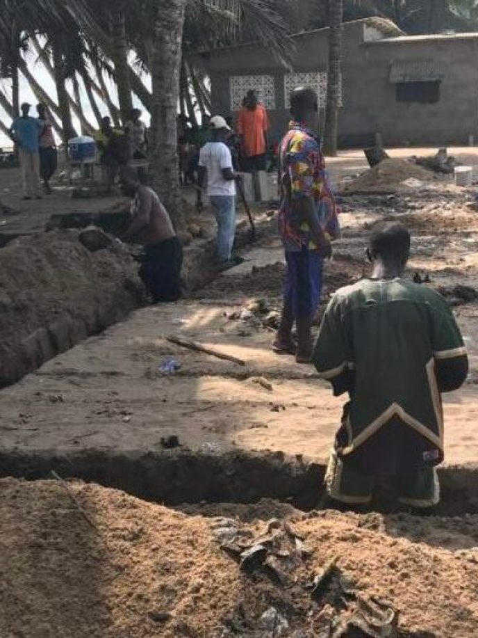People digging the foundation of the Love Africa Project's 20-toilet public washroom structure in Saltpond, Ghana
