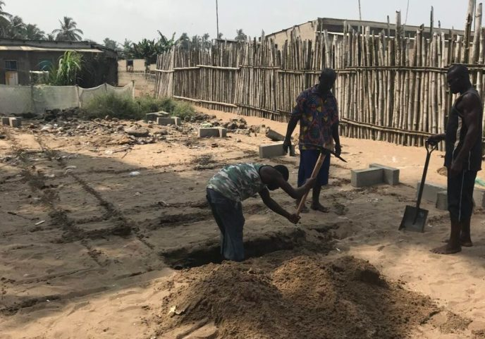 Volunteers start digging the foundation of the Love Africa Project's public washroom build, providing toilets to the community