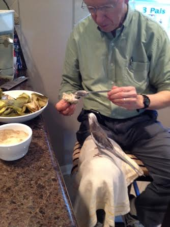 Grandpa keeps dipping that delicious-looking green thing in it.