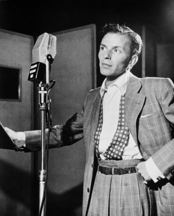 Frank Sinatra, singing suave manly songs into the microphone (image courtesy of Wikipedia).