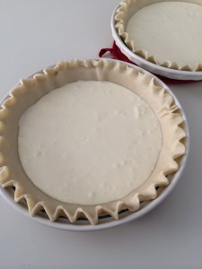 Pour cream cheese mixture into bottom of crust and spread until even.