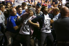 Protesters are removed from a Donald Trump rally at the Crown Center Coliseum in Fayetteville, N.C., March 9, 2016. A number of the violent incidents at Trumpís raucous rallies have had racial overtones. (Travis Dove/The New York Times)