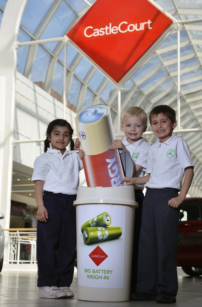 Powering ahead: CastleCourt shopping centre got a bit of help from local school children Ria Tohani (4), Nikhil McFaul (6) and Josh Mussen (6)