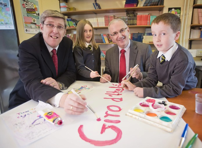 Transport Minister Danny Kennedy and Education Minister John O'Dowd with Holywood Primary school pupils, Poppy Woods (9) and Tom Muldrew (9). Picture by Brian Morrison.