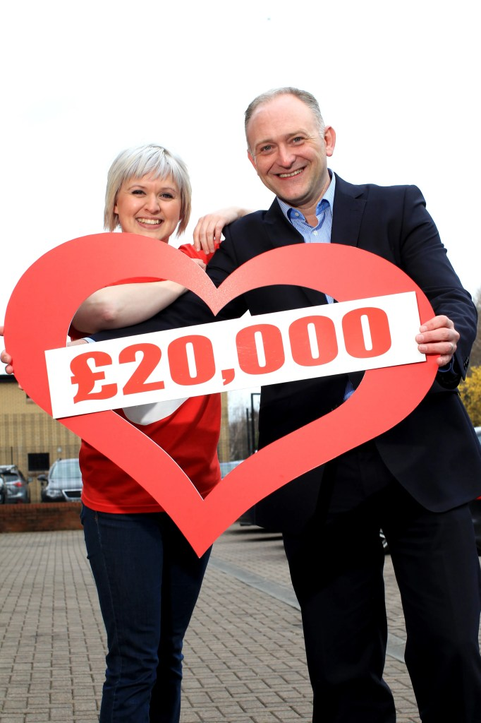 Vanessa Elder from Northern Ireland Chest Heart and Stroke is pictured with Jeff Tosh, Head of NI On Trade at Tennent's NI, celebrating reaching the campaign's target that will help the charity's work in the care and prevention of chest, heart and stroke illnesses.  The donation was raised through a twelve month programme of fundraising via sports, social and fun events.