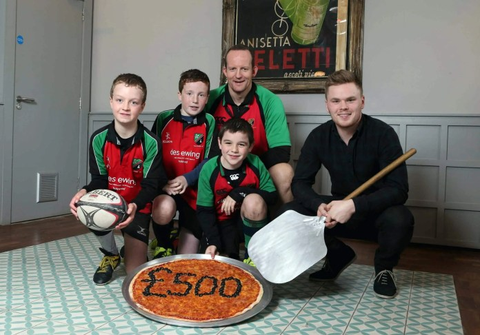 Photo by Matt Mackey, Press Eye. Pictured left to right: Front row –Harry McKeown, Gareth McConnell and Tom Muldrew from Holywood Rugby Football club join Luke Wolsey MD of Little Wing Pizzeria. Back row- Coach David Muldrew.