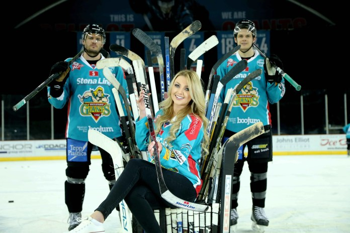 Adam Keefe and Craig Peacock of the Stena Line Belfast Giants join Meagan Green as she puts some practice in ahead of the Stena Line Belfast Giants Cruise on April 18.