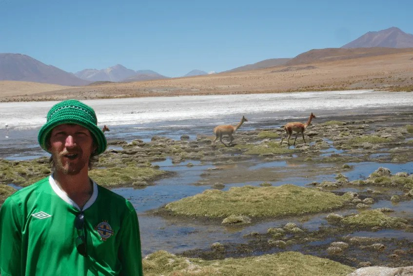 Jonny Blair relaxing with vicunas in Bolivia