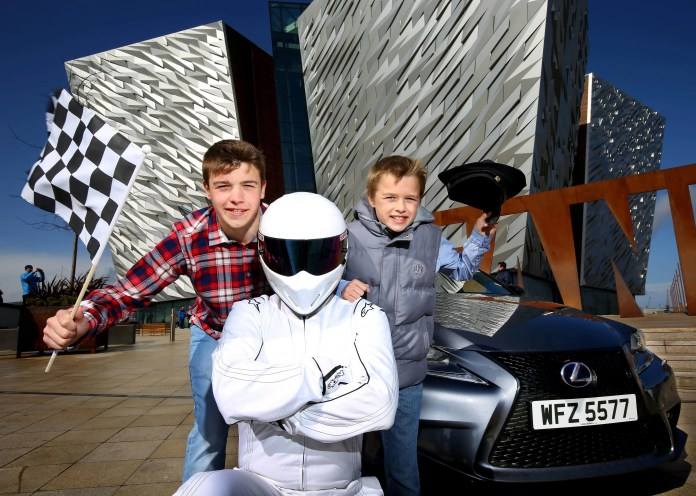 Johnathan Crookshanks (10) and his brother Matthew (14) join The Stig NI to officially launch the first Titanic Motor Show
