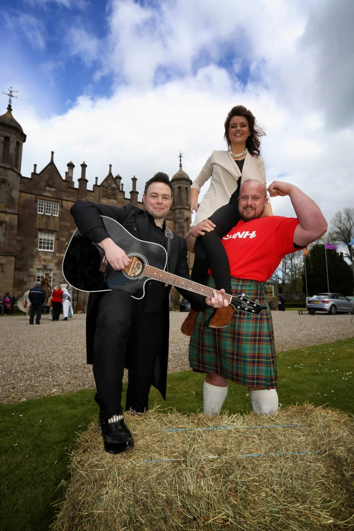 Helping to get ready for the festival  are Lyn Savage, Food N.I; strong man Chris McNaughton and J.P McCauley as Johnny Cash. Picture by Brian Morrison
