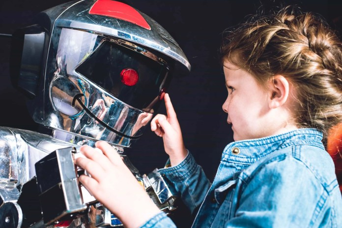 Megan Dudley (aged 5) is pictured greeting SCOOTER as one of Europe's largest privately owned collections of robots, cyborgs and androids arrive at Titanic Belfast for its ROBOTS Summer exhibition (26th June – 13th September). For more information or to buy tickets, visit www.titanicbelfast.com. Picture: Elaine Hill
