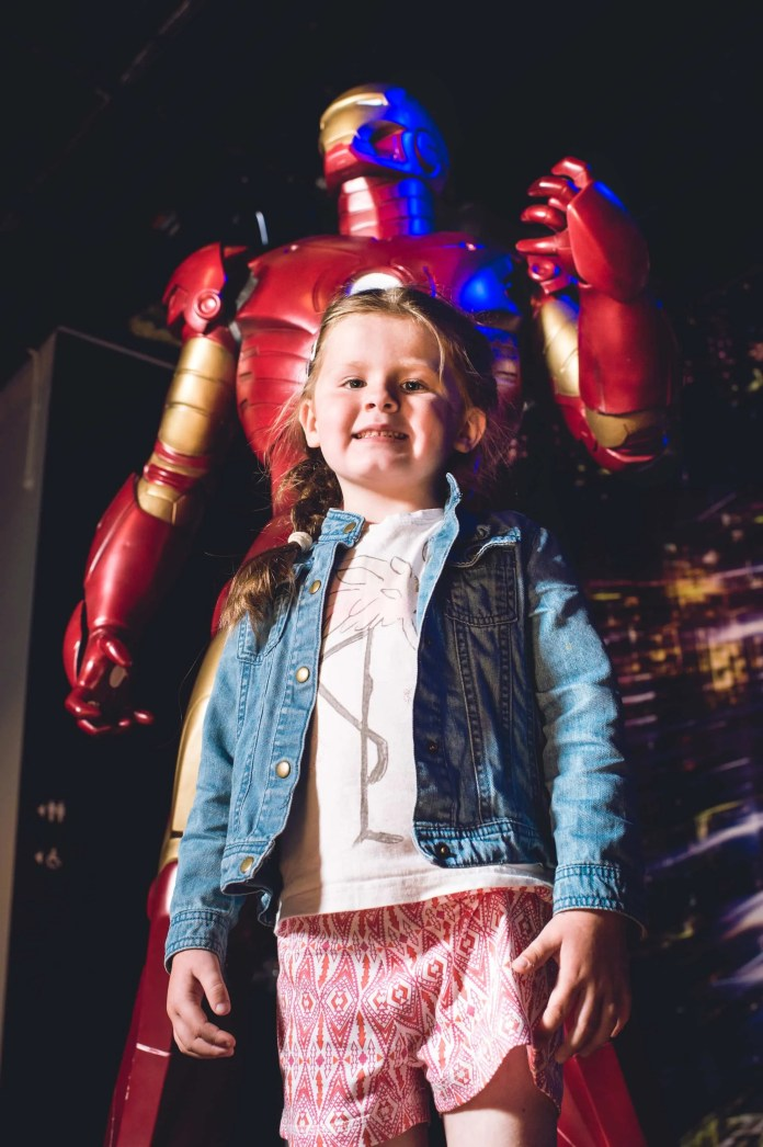 Megan Dudley (aged 5) is pictured greeting IRONMAN as one of Europe's largest privately owned collections of robots, cyborgs and androids arrive at Titanic Belfast for its ROBOTS Summer exhibition (26th June – 13th September). For more information or to buy tickets, visit www.titanicbelfast.com. Picture: Elaine Hill