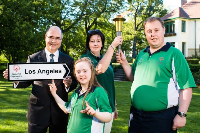 US Consul General, Gregory S. Burton with Déarbháil Savage, aged 14 from Mowhan, Co. Armagh (equestrian) & Sean Campbell, aged 30, from Coleraine, Co. Derry-Londonderry (ten pin bowling) and Naomi Morrison of the Law Enforcement Torch Run for Special Olympics.