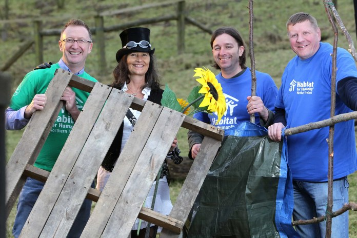 Festival organiser Vanessa Magowan joins, John Comerton, Andrew Dowling and Niall McConkey, Habitat for Humanity Northern Ireland, celebrate the organisations 21st birthday by officially launching 'Shack Attack' slum village!©Brian Thompson Photography
