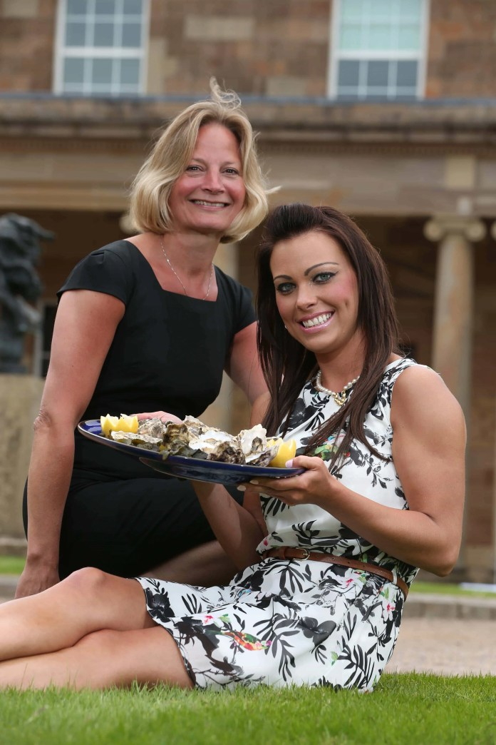 LET THE WORLD BE YOUR OYSTER The Hillsborough International Oyster Festival's very own Oyster Pearl, Emma Friars, (right) is pictured with Sarah Waugh from the Festival organising committee at the launch of this year's event at Hillsborough Castle.  The Festival runs from 1st-6th September 2015. Visit www.hillsboroughoysterfestival.com