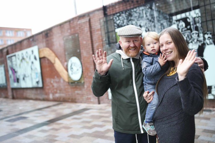 Sophie Rasmussen and Joby Fox of King Street Arts with son Ruairi Fox at the unveiling of 'A River Runs Through It'