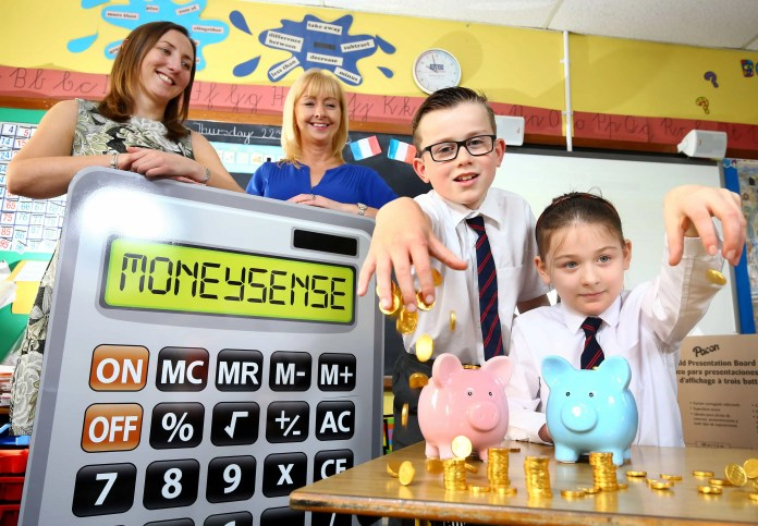 """Jill Smyth, Community Programme Manager at Ulster Bank, launches the Moneysense for primary schools initiative with the help of Miss Paul, Primary 5 teacher, Fairview Primary School, Ballyclare (left) and P5 pupils Andrew Cooper and Grace McAllister. PRESS RELEASE 3RD NOVEMBER, 2015 FINANCIAL EDUCATION PROGRAMME FOR PRIMARY SCHOOLS LAUNCHED Ulster Bank extends MoneySense initiative to cover 5-12 year olds An innovative financial education programme is being launched for primary school children in Northern Ireland. Ulster Bank is extending its popular MoneySense programme, which is currently being used by most local post-primary schools, to cover 5-12 year olds as well. Primary schools will be offered brand new, tailored content to help children begin to understand how to use money. It will cover areas such as the different ways to pay, the various types of bank accounts that are available, and why saving is important. It is free, impartial, supports the curriculum, and aims to make learning how to manage money real, relevant and engaging. Jill Smyth, Community Programme Manager at Ulster Bank, says: """"MoneySense provides an extensive range of resources that can be delivered by teachers in class, as well as activities that parents can carry out at home with their child. Teaching children about money is one of the most important things you can do to equip them for the future. MoneySense does just that."""" Teachers can register for the programme now at www.mymoneysense.com The MoneySense financial education programme has helped millions of young people learn about money in nearly 60% of schools in the UK and Ireland for over 21 years. The MoneySense programme is educationally robust, and has been created with experts to support the curriculum. All resources are 100% impartial, and never promote products. ENDS"""