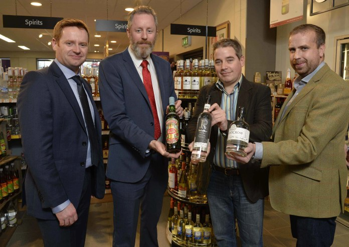 SuperValu and Centra have expanded their premium spirits range, now stocking local craft spirits Ð Shortcross Gin, Ruby Blue Vodka and DunvilleÕs Whiskey. This is the first off-licence chain in Northern Ireland to make the local craft spirits widely available across the province. Helping SuperValu/Centra Trading Manager, James McLornan (far left) launch the new additions to the premium spirits offering are (l-r) Jarlath Watson of The Echlinville Distillery in Newtownards, Stuart Hughes of Hughes Craft Distillery in Lisburn and David Boyd-Armstrong of Rademon Estate Distillery in Downpatrick.