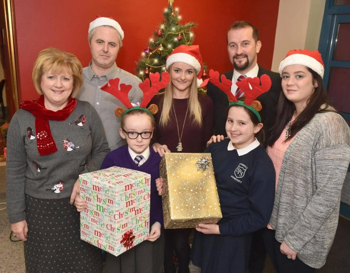 Three big hearted lottery winners, Martin McKenna, who won £1m on a Millionaire 777 scratchcard, Lauren McLarnon who bagged £100k on a Rainbow scratchcard and Claire Marks who won £250k on a Celebration scratchcard, visited two primary schools in west Belfast, St Claire's Primary School and Springfield Primary School, to help bring a little bit of Christmas cheer and some festive treats.  The schools are part of the Big Lottery Funded, Moving Up Moving On which was awarded £696,933 by the Big Lottery Fund.  The project is led by the Forthspring Intercommunity Group which works closely with the pupils and families of both schools in the Clonard, Springfield, Woodvale and Shankill areas of west Belfast to improve their life opportunities via a series of family events, homework clubs and language clubs.   Pictured at St Claire's Primary School are (l to r – back row) Kathryn Haugh from Springfield Primary School, Martin McKenna, Lauren McLarnon, Brendan Birt from St Claire's Primary School, Claire Marks and pupils from St Claire's Primary School and Springfield Primary School. Each week National Lottery players raise over £34 million for National Lottery projects across the UK.  To date more than 450,000 grants have been awarded – an average of 135 grants for every postcode district.   To find out more about Forthspring Intercommunity Group please visit www.forthspring.org. To find out more about where National Lottery funding goes, visit: www.lotterygoodcauses.org.uk/.