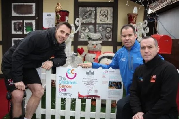 """Special Visitors for Children's Cancer Unit Charity Grotto at City Hall Ulster Rugby's Tommy Bowe, Andy Ward of Andy Ward Fitness  and Tommy Stevenson of AT Fitness greet Santa at his grotto at the Belfast Continental Christmas Market in the grounds of City Hall.  This year proceeds from the grotto will go to the Children's Cancer Unit Charity, one of the Lord Mayor's chosen charities during his year in office. Toys at the grotto have been sourced and wrapped by the CastleCourt branch of Toys'R'Us and the grotto was dressed by Homebase on Belfast's Boucher Road. Dominic Walsh of Hospital Services also kindly donated £2,500 to help pay for gifts and the running of the grotto. Other companies who have shown their support by making donations to the grotto include Value Cabs, Data Despatch, Laverys, Clubs To Hire and McQuoids Estate Agents. Jacqueline Wilkinson from the Children's Cancer Unit Charity said, """"We are delighted with the support we have received to help make our Santa's grotto a magical place for children at the Christmas market. Each of the local businesses who donated money to help with this received tickets to the grotto to the value of their donation. One of the companies also donated their tickets to a local school so that the children could come and visit Santa which was lovely."""" Tickets to the Children's Cancer Unit Charity Grotto at the Belfast Continental Christmas Market are £5 per child and photographs are also available at £5 each. Visit www.childrenscancerunit.com/ for further details."""