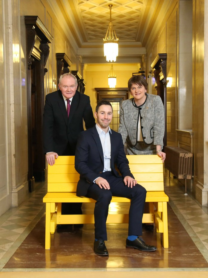 PADDY WALLACE FUND LAUNCHES NEW BUDDY BENCH SCHEME Paddy Wallace is pictured with First Minister Arlene Foster MLA and Deputy First Minister Martin Guinness MLA at the launch of the Paddy Wallace Fund for Autism 'Buddy Bench' initiative in Northern Ireland.