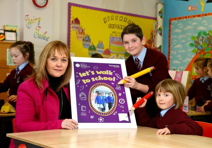WALK THIS WAY… Transport Minister Michelle McIlveen joins pupils from Portavogie Primary School Adam Stevenson and Casey Cully to launch Walk to School Week which takes place from May 16 - 20.  The scheme will see pupils from over 200 schools across Northern Ireland leading the way in sustainable travel.  Any school that registers to participate will receive copies of the new 'Let's Walk to School' workbook, designed by Travelwise NI to help educate primary school pupils on the benefits of walking and the importance of road safety.  Schools can register for Walk to School Week to receive support material and to be entered into the competition to win a carnival themed walk by email to travelwiseni@drdni.gov.uk, by post to Travelwise NI, Clarence Court, 10-18 Adelaide Street, Belfast, BT2 8GB or by telephone on 028 9054 0096 before Friday April 29.