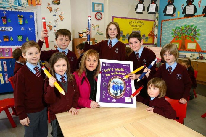 WALK THIS WAY… Transport Minister Michelle McIlveen joins pupils from Portavogie Primary School to launch Walk to School Week which takes place from May 16 - 20.  The scheme will see pupils from over 200 schools across Northern Ireland leading the way in sustainable travel.  Any school that registers to participate will receive copies of the new 'Let's Walk to School' workbook, designed by Travelwise NI to help educate primary school pupils on the benefits of walking and the importance of road safety.  Schools can register for Walk to School Week to receive support material and to be entered into the competition to win a carnival themed walk by email to travelwiseni@drdni.gov.uk, by post to Travelwise NI, Clarence Court, 10-18 Adelaide Street, Belfast, BT2 8GB or by telephone on 028 9054 0096 before Friday April 29.