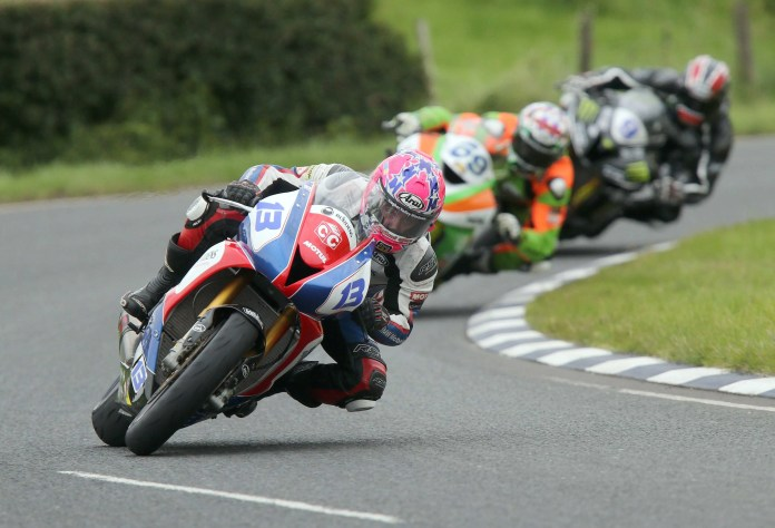 PACEMAKER, BELFAST, 8/8/2015: Lee Johnston (East Coast Construction Triumph) leads Glenn Irwin (Gearlink Kawasaki) and Ian Hutchinson (Team Traction Control Yamaha) at Quarry Bends during the second Supersport race at the Ulster Grand Prix. PICTURE BY STEPHEN DAVISON