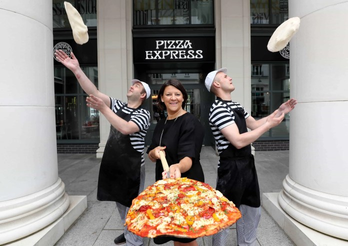 Operations Director at Pizza Express, Zoe Bowley is pictured alongside two of the restaurant's Pizzaiolos at the new store in St. Anne's Square. Zoe was in Belfast to announce that two more restaurants are due to open on 09 September, bringing the total number of Pizza Express restaurants in Belfast to five.