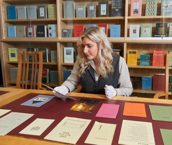Rebecca Gordon with the collection of Christmas cards being curated for the new exhibition opening at Seamus Heaney Heaney HomePlace n 18 December 2017