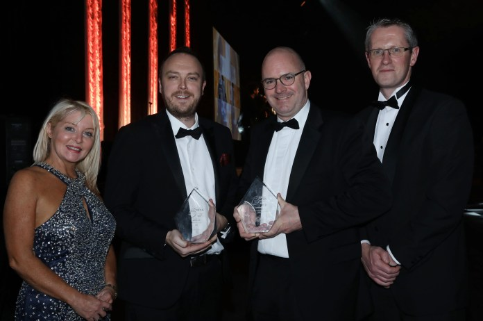 FinTrU - BEFTA18 Company of the Year winners sponsored by First Trust Bank - presented by Adrian Moynihan - Head of First Trust Bank (right) and Brenda Buckley - Business Eye