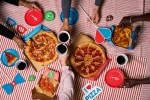 DOMINO'S THROWSBIGGEST EVERBANK HOLIDAY PIZZA PARTY WITH 50,000 SLICE GIVEAWAY