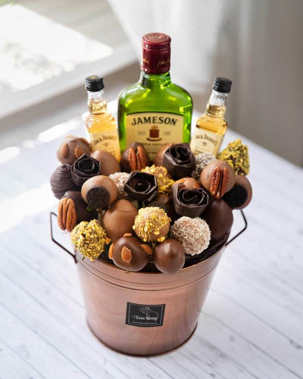 chocolate strawberry arrangements with alcohol bottle