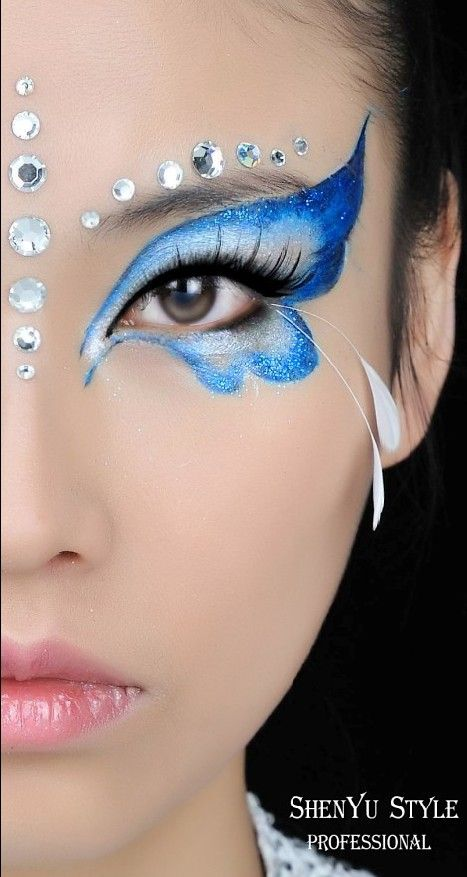 Butterfly Face Paint with Feather and Gem Accents