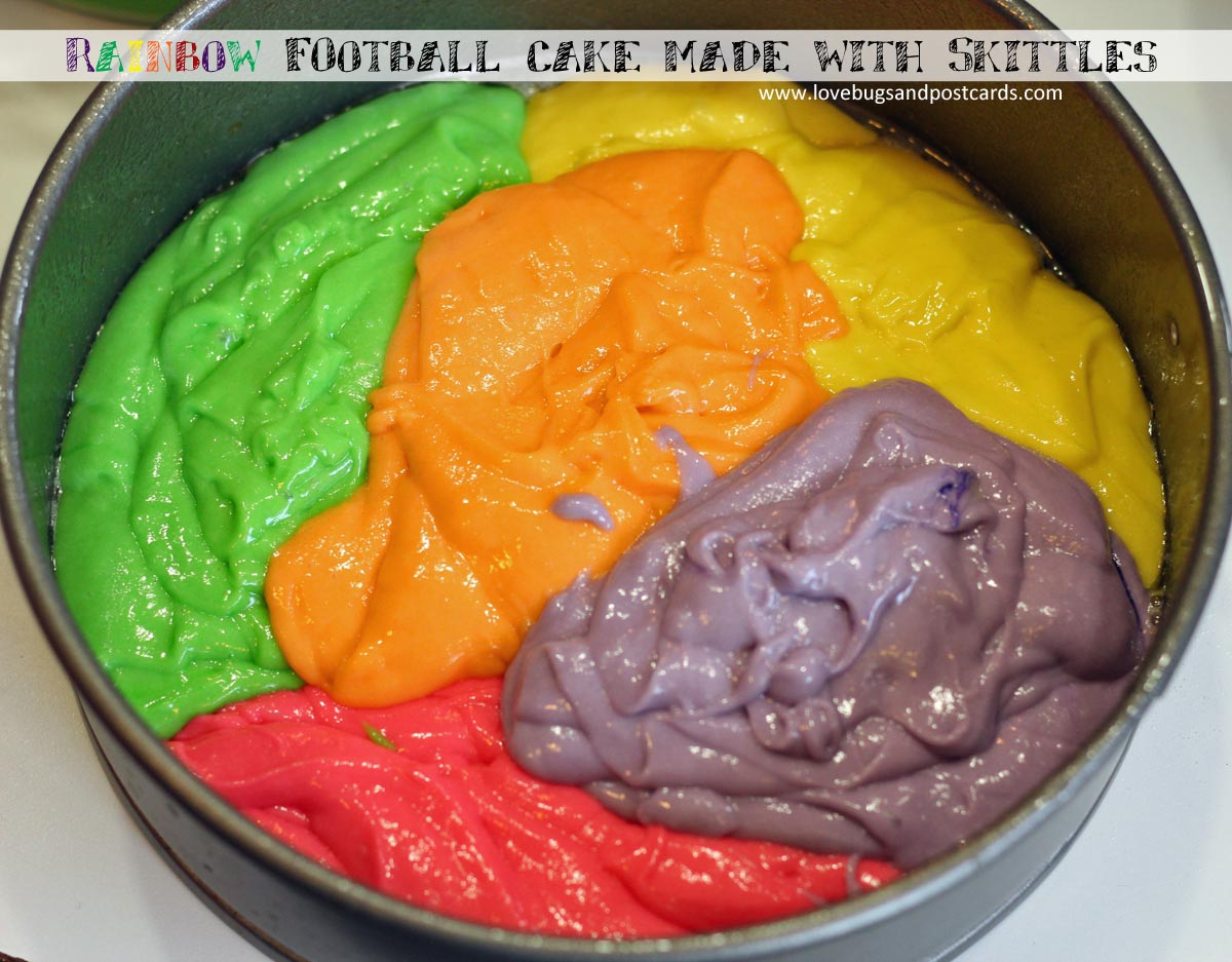 Football Rainbow cake made with Skittles for Super Bowl fun #MakeSB50Sweeter