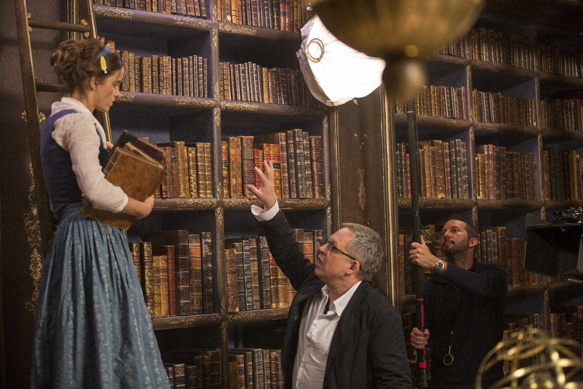 Director/co-screenwriter Bill Condon on set with Belle (Emma Watson) in Disney's BEAUTY AND THE BEAST, a live-action adaptation of the studio's animated classic. The story and characters audiences know and love are brought to life in this stunning cinematic event...a celebration of one of the most beloved stories ever told.