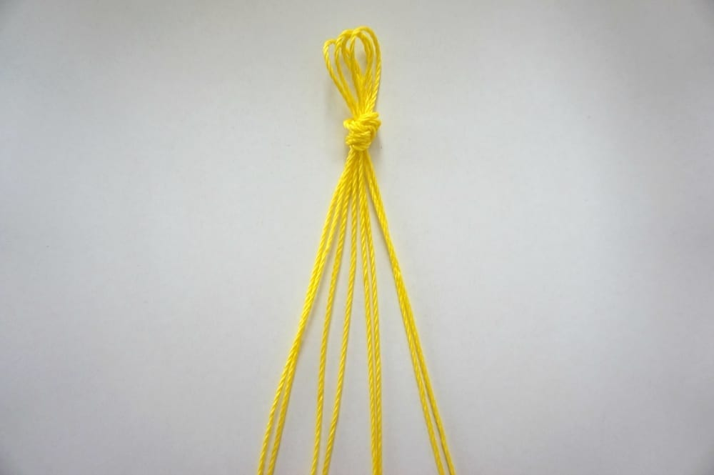 Yellow twine knotted