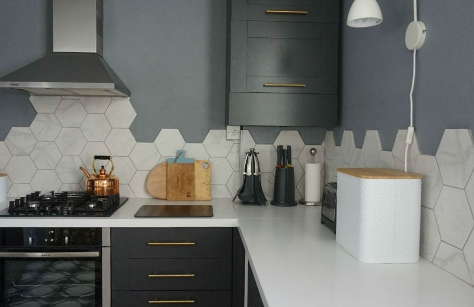 hexagonal wall tiles in a white and grey kitchen