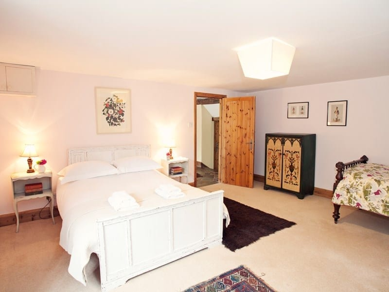 Country cottage double bedroom with white bed