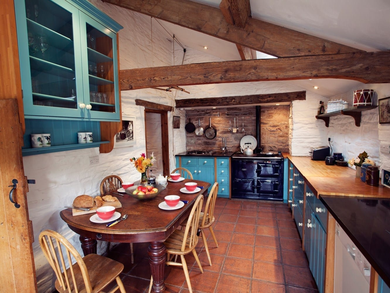 rustic country kitchen with dining table and chairs