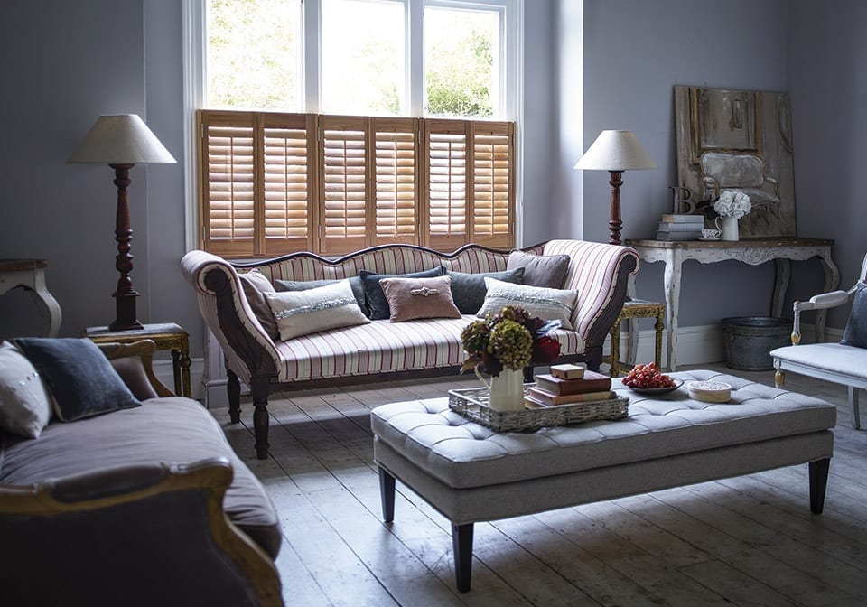 stylish living room with cafe style window shutters