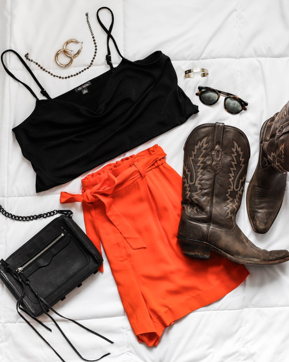 football game day outfit cowboy boots glam orange and black inspiration