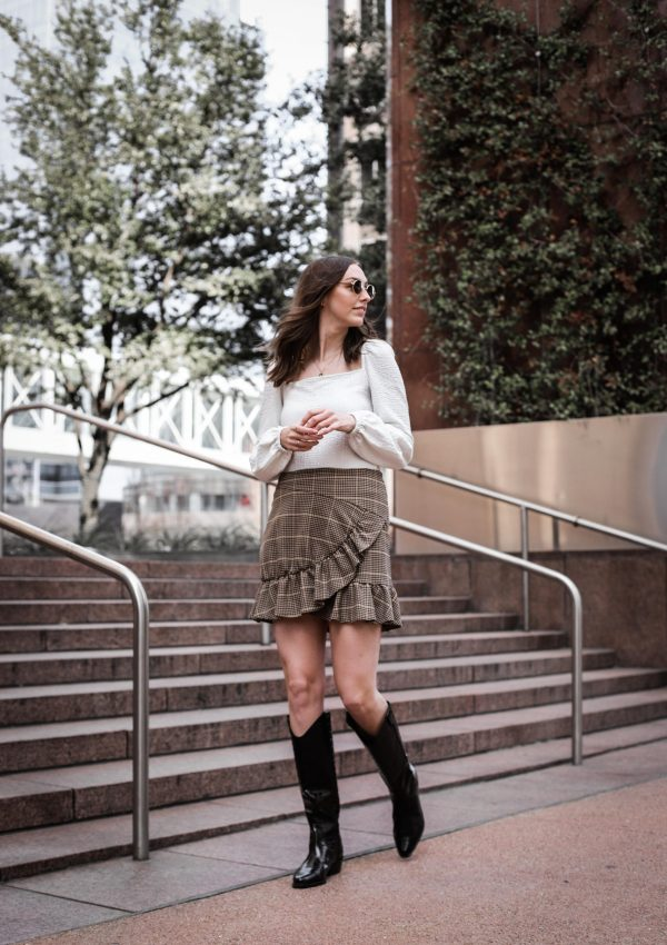 plaid skirt and white peasant top black riding boots