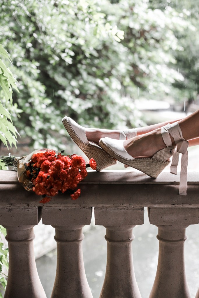 espadrille sandals and bouquet of flowers