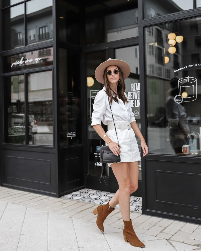 all white fall outfit walking photo